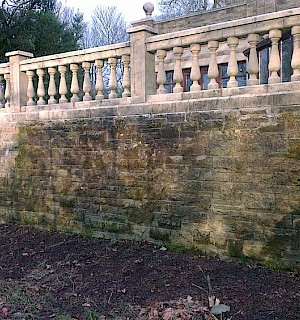 Steps and balustrade stone wall before